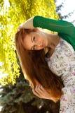 Redhead y viento Fotos de archivo