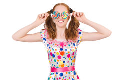 Redhead young girl with lolipops Stock Photography