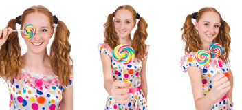 The redhead young girl with lolipops isolated on white Stock Photography