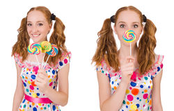 The redhead young girl with lolipops isolated on white Royalty Free Stock Photo