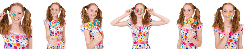 The redhead young girl with lolipops isolated on white Royalty Free Stock Image