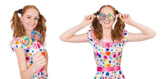 The redhead young girl with lolipops isolated on white Stock Images