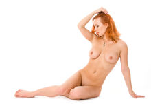 Redhead young naked woman Royalty Free Stock Image