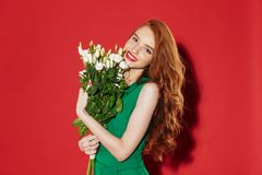 Redhead young shocked girl in green dress Royalty Free Stock Photography