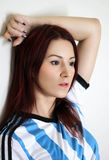 The redhead young woman in argentinean socker trikot Royalty Free Stock Images