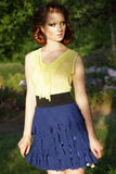 Redhead Young Woman in Blue Skirt Looking Away Royalty Free Stock Images