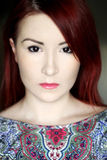 Redhead young woman in bright colorful top portrait Stock Photography
