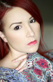 Redhead young woman in bright colorful top portrait Royalty Free Stock Image