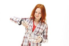 Redhead young woman cooks dinner Royalty Free Stock Photos