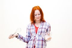 Redhead young woman cooks dinner Stock Photo