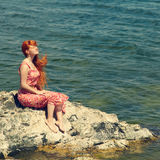 Redhead young woman in a dress on the ocean coast Stock Photography