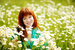 Redhead  young woman in the feild Stock Image