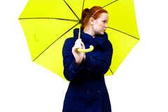 Redhead young woman holding an  umbrella Royalty Free Stock Images