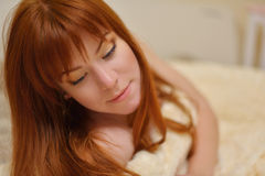 Redhead young woman Royalty Free Stock Image