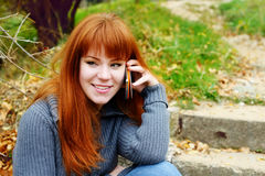 Redhead young woman Stock Images