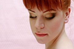 Redhead young woman. Portrait of redhead young woman with make up Royalty Free Stock Images