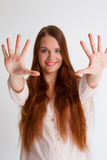 Redhead young woman showing open hands to the front Royalty Free Stock Image