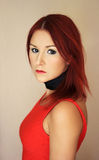 The redhead youngredhead woman in red dress portrait Royalty Free Stock Images