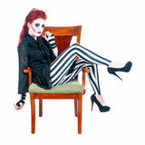 Redhead Zombie Woman Seated Royalty Free Stock Photo