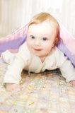 Redheaded baby boy under blanket Royalty Free Stock Photos