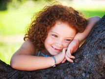 Redheaded beautiful girl. On a background of nature Stock Photos