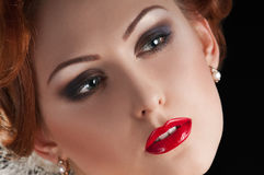 Redheaded beauty. Portrait of redheaded beautiful girl on black stock images