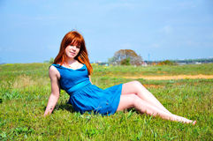 Redheaded beauty on the meadow Royalty Free Stock Photo