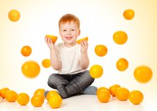 Redheaded boy with falling oranges Royalty Free Stock Image