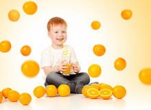 Redheaded boy with falling oranges and juice Stock Images