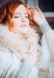 Redheaded bride basking on the winter sun Royalty Free Stock Photo