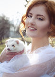 Redheaded bride basking in the winter sun Stock Images