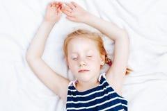Free Redheaded Caucasian Child Girl In Striped Nautical Sleeveless Shirt Sleeping Stock Photo - 96952350