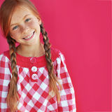 Redheaded child. Cute redheaded child on red background royalty free stock photos