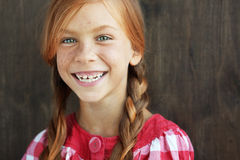 Redheaded child. Cute redheaded child on vintage brown background royalty free stock image