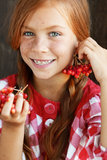 Redheaded child. Cute redheaded child on vintage brown background royalty free stock photography