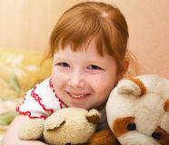 Redheaded child with teddy bears. Redheaded nice girl with teddy bears royalty free stock images