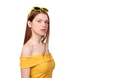 Redheaded female in yellow top and sunglasses Stock Photos