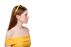 Redheaded female in yellow top and sunglasses Royalty Free Stock Photography