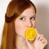 redheaded flickaorange Royaltyfria Bilder