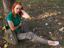 Redheaded girl. With makeup in front of a tree Stock Images