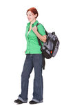 Redheaded girl backpacker. Redheaded teenage backpacker against a white background Royalty Free Stock Photos