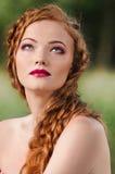 Redheaded girl face Stock Photos
