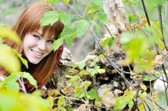 Redheaded girl in forest Royalty Free Stock Photos