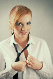 Redheaded girl  in formal dress like a secretary. With white shirt and tie Stock Photos