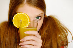Redheaded  girl with orange Stock Photos