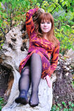 Redheaded girl resting in forest Stock Photos