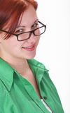 Redheaded girl student. Portrait of a redheaded girl student with glasses Royalty Free Stock Image