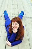 Redheaded girl wearing blue clothes Stock Image
