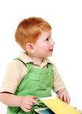 Redheaded kid with book Royalty Free Stock Image