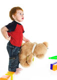 Redheaded kid with teddy bear Royalty Free Stock Photography